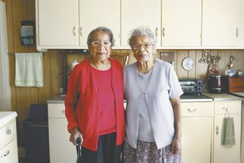 Sisters Dorothy Ray Coone and Charity Ray are active in preserving the legacy of the Anderson Rosenwald School in Mars Hill. Photo by Matt Rose